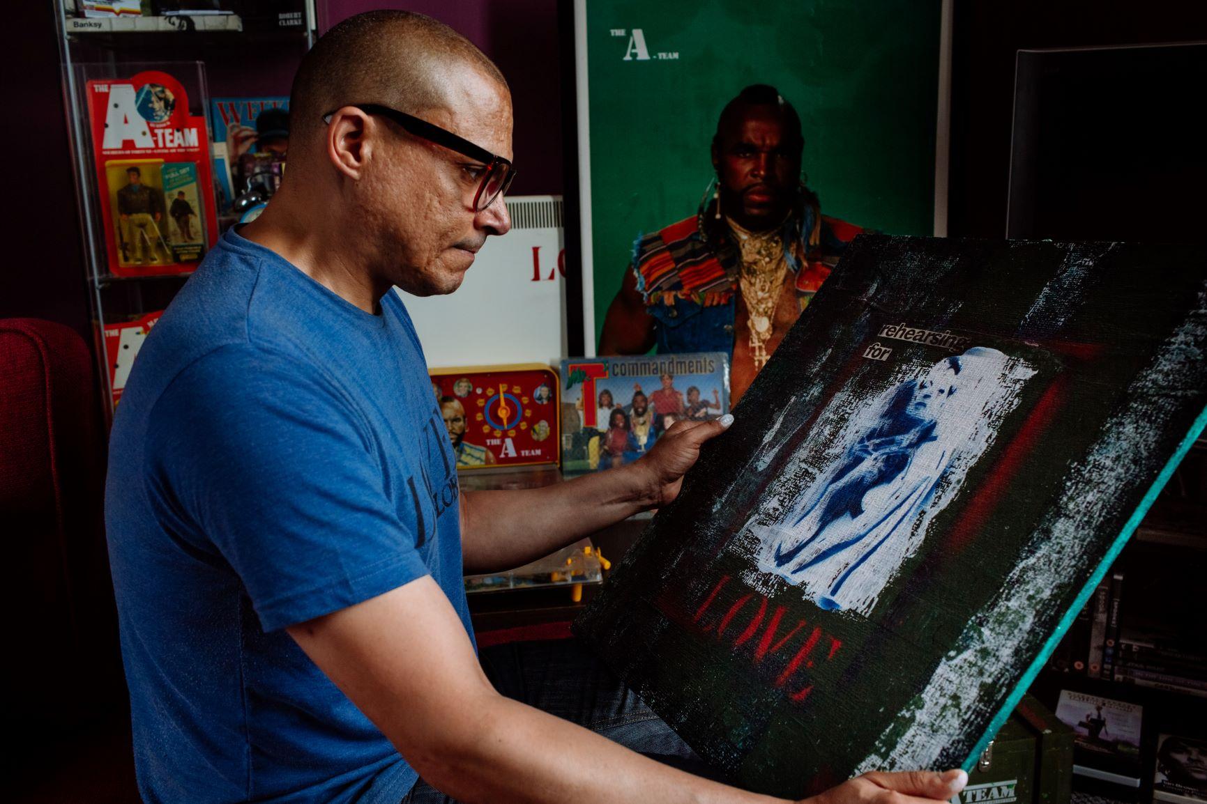 Image of Jason Wheeler with his artwork